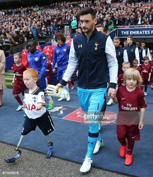 Hugo Lloris of Tottenham Hotspur walks out with mascot Marshall Janson during The Emirates FA Cup SemiFinal between Chelsea and Tottenham Hotspur at...