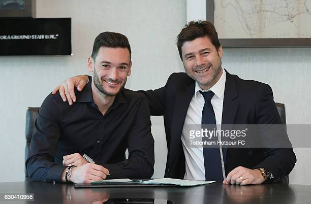 Hugo Lloris of Tottenham poses with manager Mauricio Pochettino after signing a new contract with Tottenham Hotspur at Tottenham Hotspur Training...