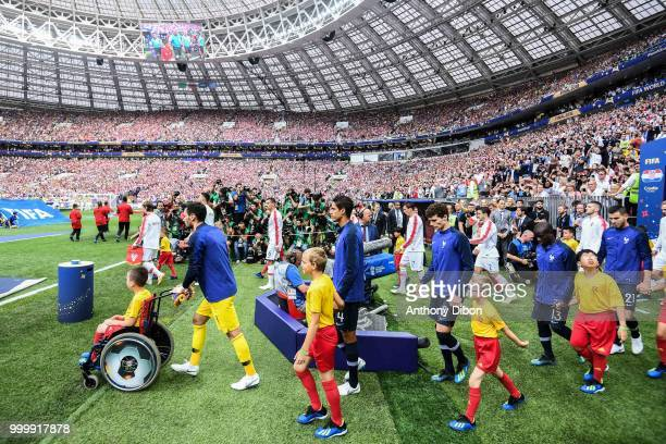 Hugo Lloris Raphael Varane Benjamin Pavard Ngolo Kante Lucas Hernandez of France enter on the pitch during the World Cup Final match between France...
