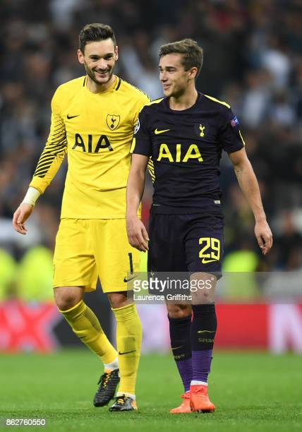 Hugo Loris of Tottenham Hotspur shares a moment with Harry Winks after drawing the UEFA Champions League group H match between Real Madrid and...
