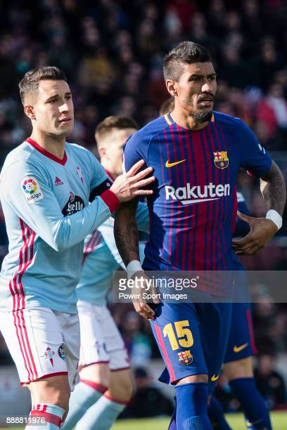 Hugo Mallo Novegil of RC Celta de Vigo fights for position with Paulinho of FC Barcelona during the La Liga 201718 match between FC Barcelona and RC...