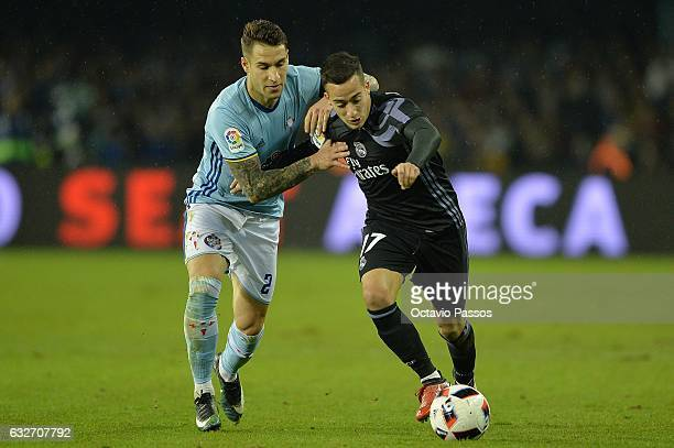Hugo Mallo of Celta de Vigo competes for the ball with Lucas Vázquez of Real Madrid during the Copa del Rey quarterfinal second leg match between...