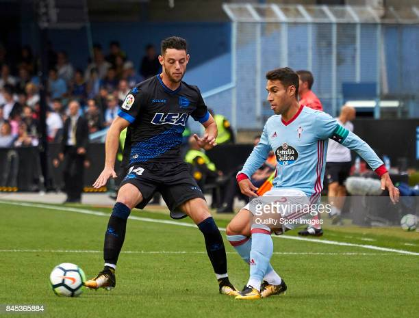 Hugo Mallo of Celta de Vigo is challenged by Jorge Franco 'Burgui' of Deportivo Alaves during the La Liga match between Celta de Vigo and Deportivo...