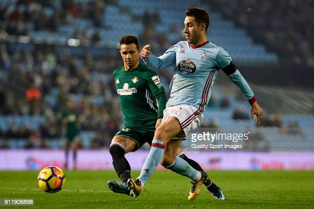 Hugo Mallo of Celta de Vigo is challenged by Ruben Castro of Real Betis during the La Liga match between Celta de Vigo and Real Betis at Balaidos...