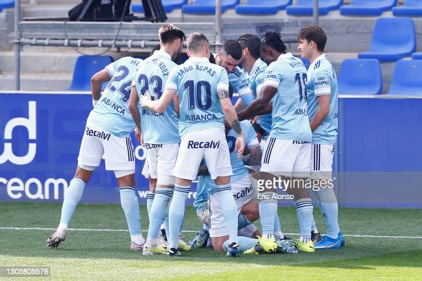Hugo Mallo of Celta Vigo ccelebrates with team mates after scoring their side's third goal during the La Liga Santander match between SD Huesca and...