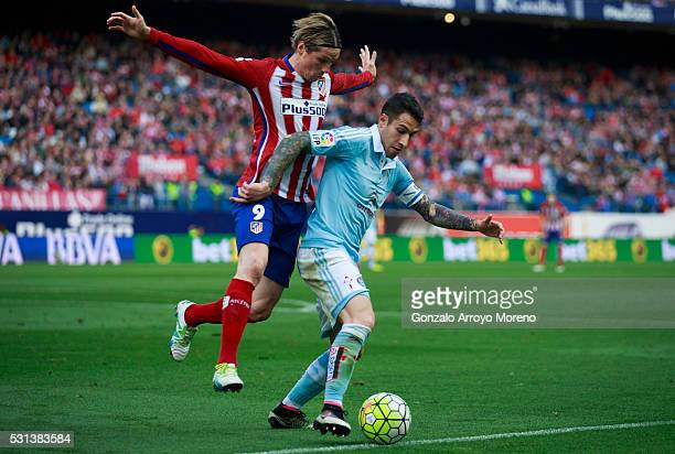 Hugo Mallo of RC Celta de Vigo competes for the ball with Fernando Torres of Atletico de Madridduring the La Liga match between Club Atletico de...