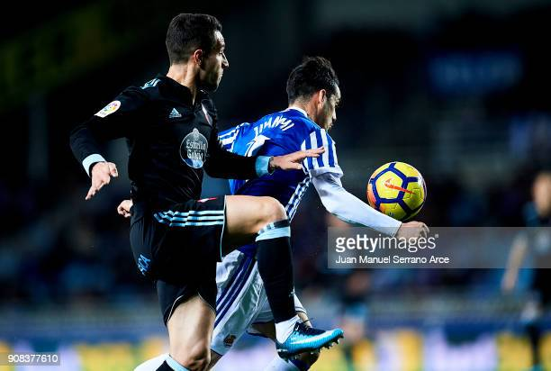 Hugo Mallo of RC Celta de Vigo duels for the ball with Juan Miguel Jimenez 'Juanmi' of Real Sociedad during the La Liga match between Real Sociedad...