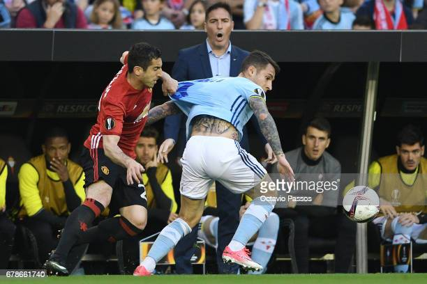 Hugo Mallo of RC Celta in action against Henrikh Mkhitaryan of Manchester United during the UEFA Europa League semi final first leg match between...