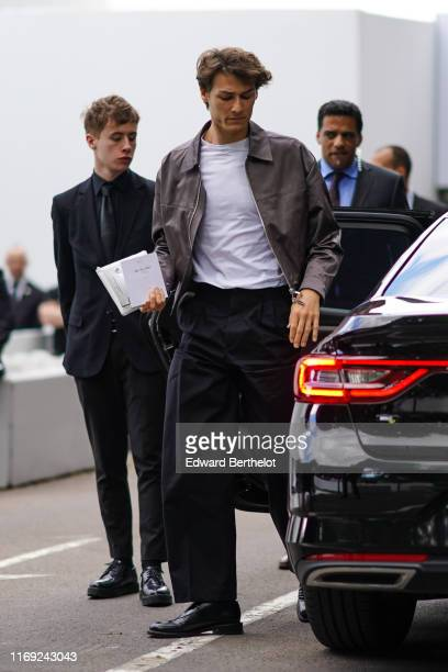 Hugo Marchand wears a white tshirt a grey jacket black trousers black shoes outside Dior during Paris Fashion Week Menswear Spring/Summer 2020 on...