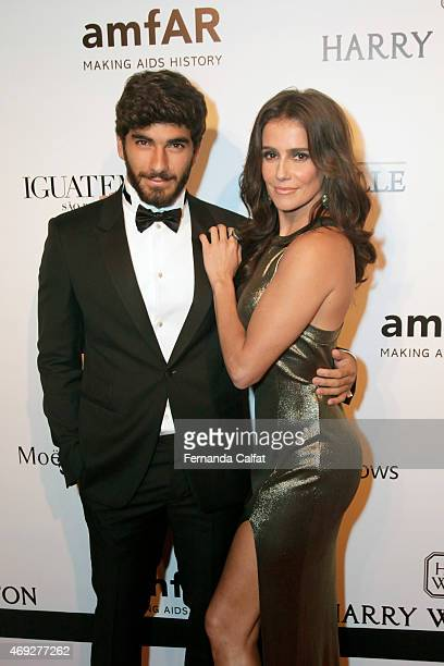 Hugo Moura and Deborah Secco attend the 5th Annual amfAR Inspiration Gala at the home of Dinho Diniz on April 10 2015 in Sao Paulo Brazil