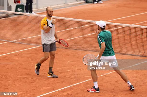 Hugo Nys of Monaco and Tim Puetz of Germany celebrate after winning match point during their Men's Doubles Second Round match against Rajeev Ram of...