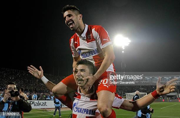 Hugo Oliveira Vieira and Marko Grujic of FK Crvena Zvezda celebrate victory after the Serbian Super League match between FK Partizan and FK Crvena...