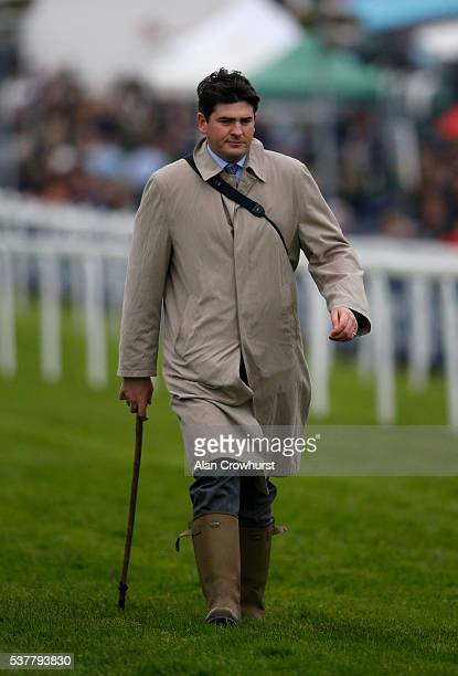 Hugo Palmer on the course with his going stick at Epsom Racecourse on June 3 2016 in Epsom England