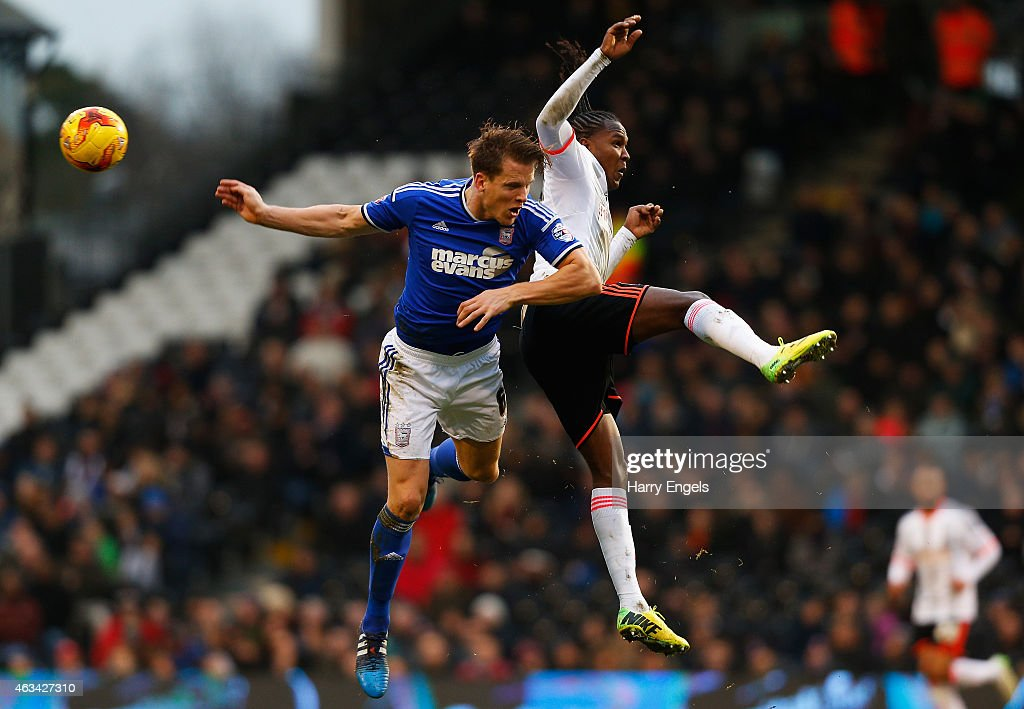 Hugo Rodallega of Fulham (R) and Christophe Berra of Ipswich Town (L) collide in midair during the Sky Bet Championship match between Fulham and Ipswich Town at Craven Cottage on February 14, 2015 in London, England.