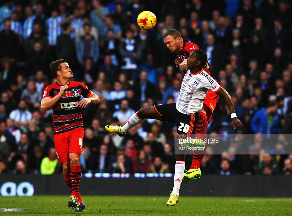 Hugo Rodallega (#20) of Fulham and Joel Lynch of Huddersfield Town challenge for the ball during the Sky Bet Championship match between Fulham and Huddersfield Town at Craven Cottage on November 8, 2014 in London, England.