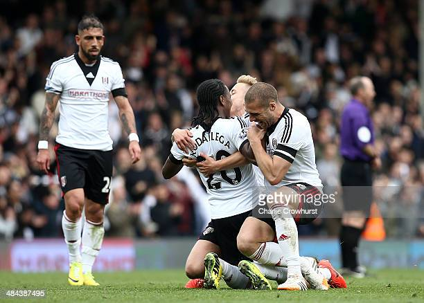 Hugo Rodallega of Fulham celebrates the teams win with Lewis Holtby and Pajtim Kasami at the final whistle during the Barclays Premier League match...