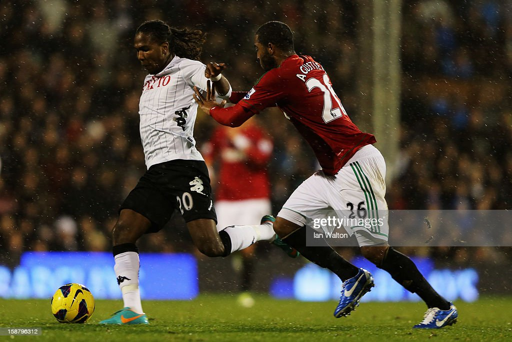 Hugo Rodallega (L) of Fulham holds off the challenge of Kemy Agustien (R) of Swansea City during the Barclays Premier League match between Fulham and Swansea City at Craven Cottage on December 29, 2012 in London, England.