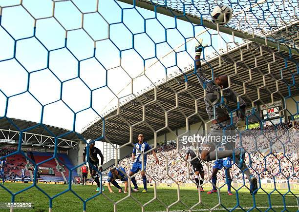 Hugo Rodallega of Fulham scores the opening goal past Ali Al Habsi of Wigan Athletic during the Barclays Premier League match between Wigan Athletic...