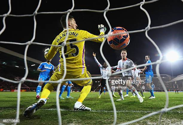 Hugo Rodallega of Fulham scores the opening goal past Vito Mannone of Sunderland during the FA Cup Fourth Round Replay match between Fulham and...