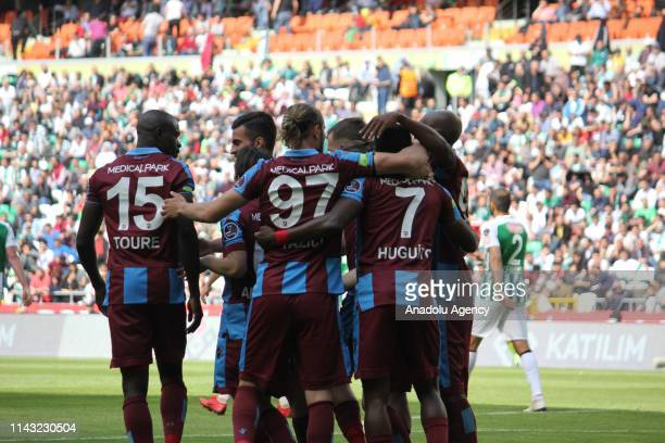 Hugo Rodallega of Trabzonspor celebrates with his teammates after scoring during a Turkish Super Lig week 32 football match between Atiker Konyaspor...