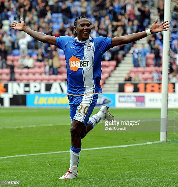 Hugo Rodallega of Wigan Athletic celebrates scoring his side's second goal during the Barclays Premier League match between Wigan Athletic and...