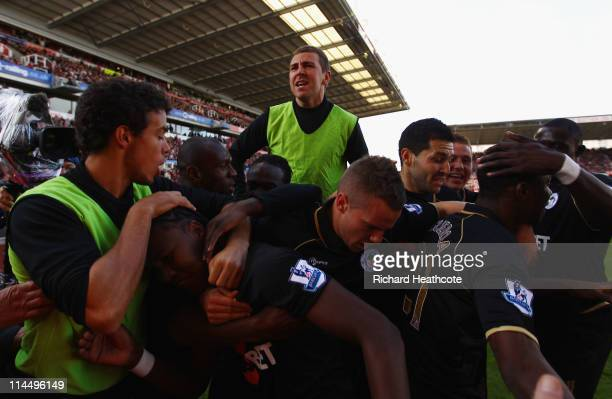 Hugo Rodallega of Wigan is mobbed by his team mates after scoring the first goal during the Barclays Premier League match between Stoke City and...