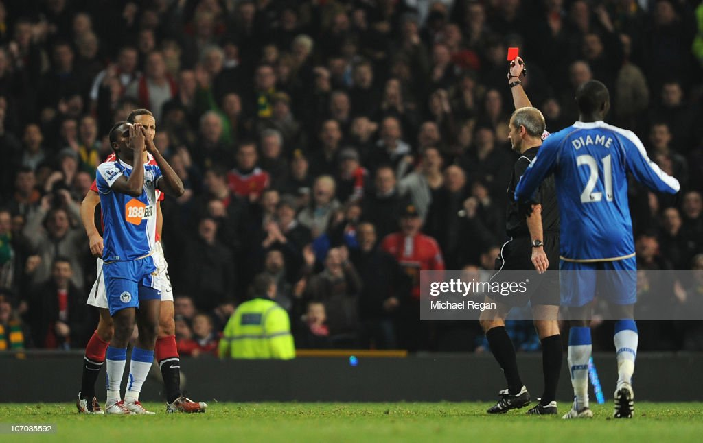 Hugo Rodallega of Wigan reacts as he is sent off by referee Martin Atkinson during the Barclays Premier League match between Manchester United and Wigan Athletic at Old Trafford on November 20, 2010 in Manchester, England.