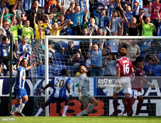 Hugo Rodallega of Wigan scores during the Barclays Premier League match between Wigan Athletic and West Ham United at the DW Stadium on September 12...