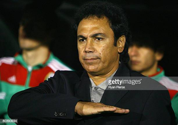 Hugo Sanchez manager of Mexico sings the national anthem before the International Friendly match between Ghana and Mexico at Craven Cottage on March...