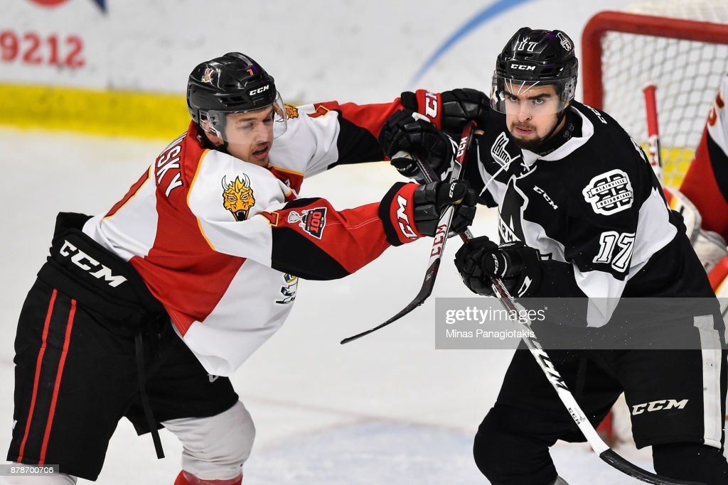 Hugo Savinsky #7 of the Baie-Comeau Drakkar challenges Thomas Ethier #17 of the Blainville-Boisbriand Armada during the QMJHL game at Centre d'Excellence Sports Rousseau on November 24, 2017 in Boisbriand, Quebec, Canada. The Blainville-Boisbriand Armada defeated the Baie-Comeau Drakkar 5-3.