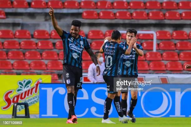 Hugo Silveira of Querétaro celebrates the second scored goal of Queretaro during the 11th round match between Queretaro and Atletico San Luis as part...