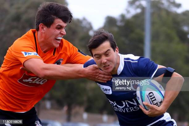 Hugo Smith of Queensland Country fends during the National U19s Championship 3rd Place Play-Off between NSW Country URC and Queensland Country URC at...