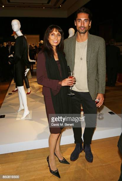 Hugo Taylor and mother attend the opening reception for 'Audrey Hepburn The Personal Collection' at Christie's on September 21 2017 in London England