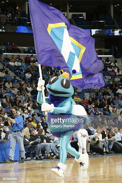 Hugo the Hornet mascot of the New Orleans Hornets runs with a flag during an intermission in the game against the Memphis Grizzlies at New Orleans...