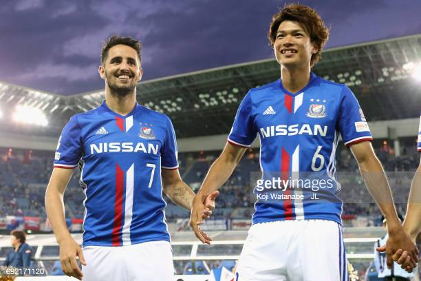Hugo Vieira and Takahiro Ogihara of Yokohama F.Marinos celebrate their 2-0 victory in the J.League J1 match between Yokohama F.Marinos and Kawasaki...