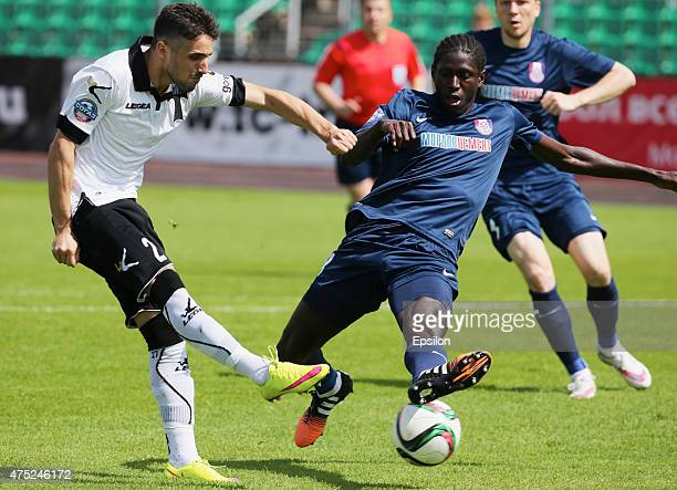Hugo Vieira of FC Torpedo Moscow is challenged by Ibrahima Niasse of FC Mordovia Saransk during the Russian Premier League match between FC Torpedo...