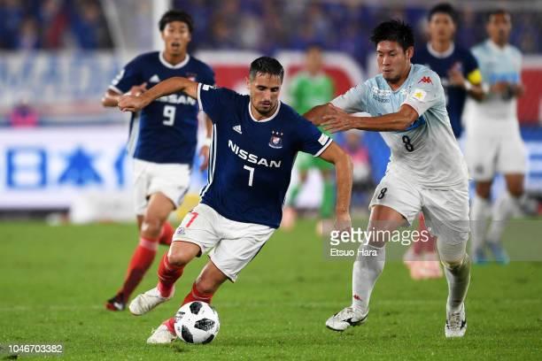 Hugo Vieira of Yokohama F.Marinos and Kazuki Fukai of Consadole Sapporo compete for the ball during the J.League J1 match between Yokohama F.Marinos...