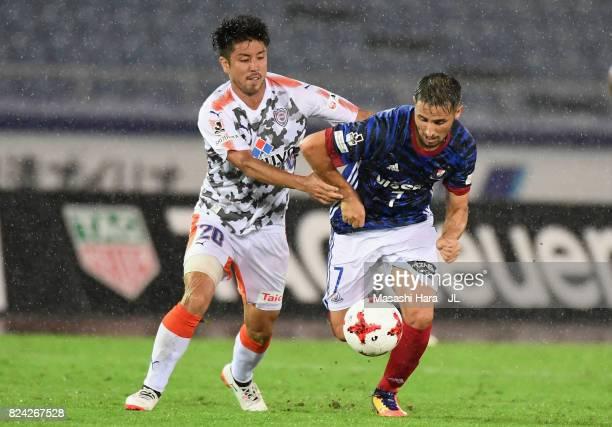 Hugo Vieira of Yokohama F.Marinos and Ryo Takeuchi of Shimizu S-Pulse during the J.League J1 match between Yokohama F.Marinos and Shimizu S-Pulse at...
