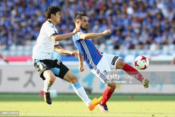 Hugo Vieira of Yokohama F.Marinos and Shogo Taniguchi of Kawasaki Frontale compete for the ball during the J.League J1 match between Yokohama...