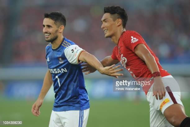 Hugo Vieira of Yokohama FMarinos and Tomoaki Makino of Urawa Red Diamonds looks on during the JLeague J1 match between Yokohama FMarinos and Urawa...