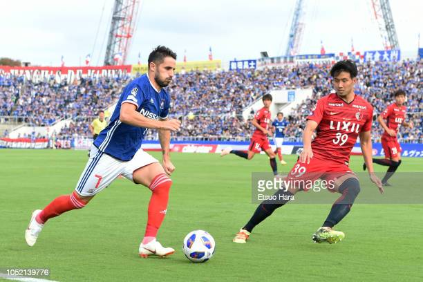 Hugo Vieira of Yokohama F.Marinos and Tomoya Inukai of Kashima Antlers compete for the ball during the J.League Levain Cup semi final second leg...