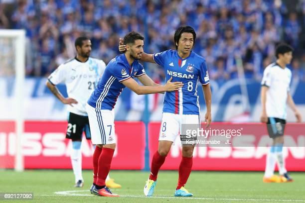 Hugo Vieira of Yokohama F.Marinos celebrates scoring the opening goal with his team mate Kosuke Nakamachi during the J.League J1 match between...