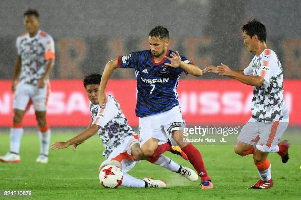 Hugo Vieira of Yokohama F.Marinos competes for the ball against Ryo Takeuchi and Mitsunari Musaka of Shimizu S-Pulse during the J.League J1 match...