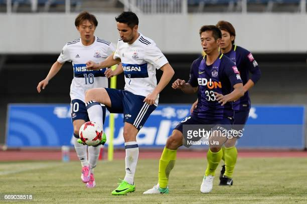 Hugo Vieira of Yokohama FMarinos controls the ball under pressure of Tsukasa Shiotani of Sanfrecce Hiroshima during the JLeague J1 match between...