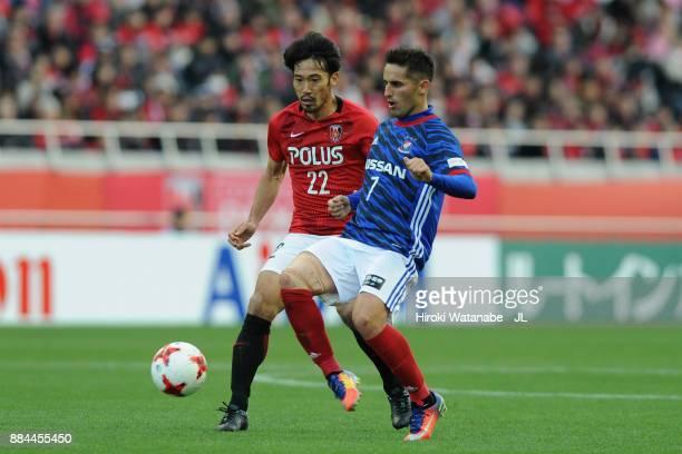Hugo Vieira of Yokohama FMarinos controls the ball under pressure of Yuki Abe of Urawa Red Diamonds during the JLeague J1 match between Urawa Red...