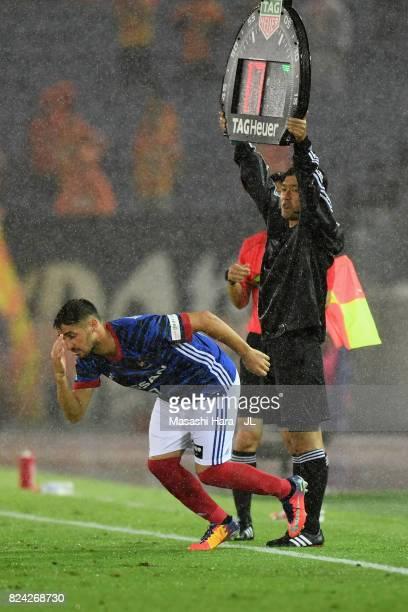 Hugo Vieira of Yokohama F.Marinos is brought in during the J.League J1 match between Yokohama F.Marinos and Shimizu S-Pulse at Nissan Stadium on July...