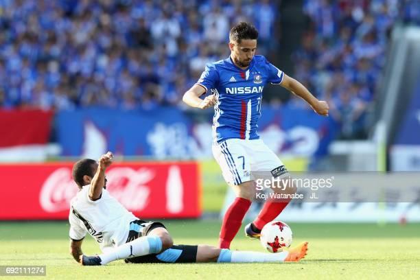 Hugo Vieira of Yokohama F.Marinos is tackled by Eduardo Neto of Kawasaki Frontale during the J.League J1 match between Yokohama F.Marinos and...