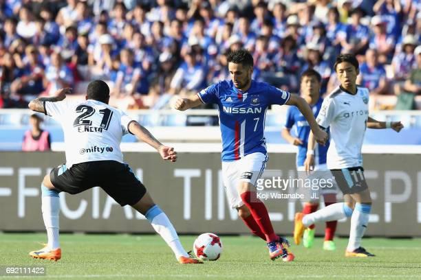 Hugo Vieira of Yokohama F.Marinos takes on Eduardo Neto of Kawasaki Frontale during the J.League J1 match between Yokohama F.Marinos and Kawasaki...