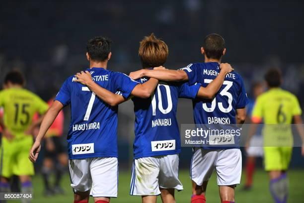 Hugo Vieira,Manabu Saito and David Babunski of Yokohama F.Marinos celebrate the win during the 97th Emperor's Cup Round of 16 match between Yokohama...