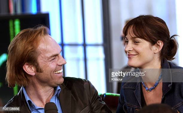 Hugo Weaving and CarrieAnne Moss during The Cast of 'The Matrix Reloaded' and POD Visit MTV's 'TRL' May 5 2003 at MTV Studios Times Square in New...